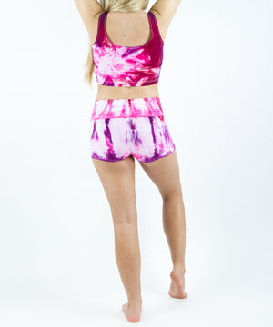Pink and purple tie dye yoga shorts with a fold over waistband.