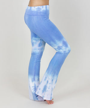 Woman wearing a pair of blue and white fold over yoga pants made of sustainable cotton.