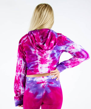 Load image into Gallery viewer, Woman wearing a pink and purple tie dye hoodie crop top.