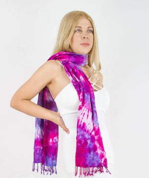 Woman wearing a pink and purple tie dye scarf by Akasha Sun.