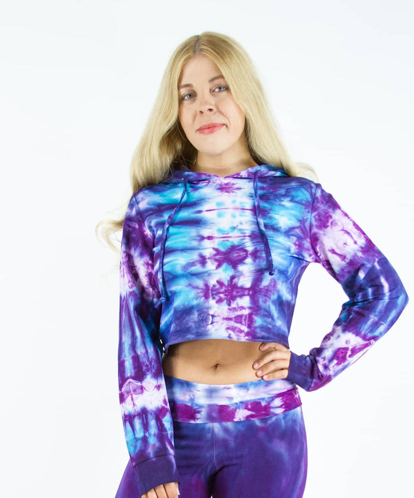 Load image into Gallery viewer, Woman wearing a purple and blue tie dye crop top hoodie by Akasha Sun.