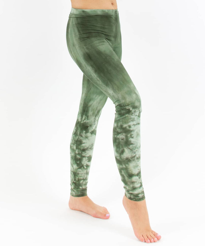 Woman wearing a pair of green tie dye leggings perfect for yoga.