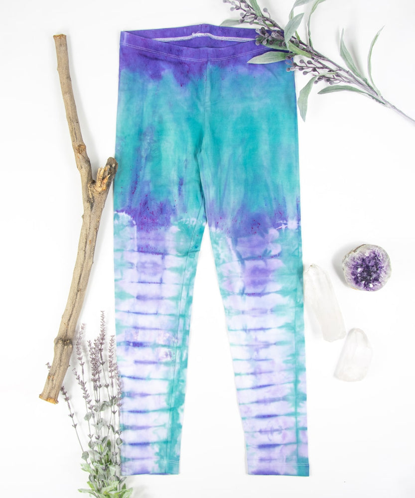 Teal and purple tie dye leggings made of sustainable cotton.