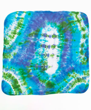 Blue and green tie dye baby gift set that includes an organic cotton baby blanket, baby hat, and onesie.