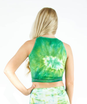 Woman wearing a green tie dye crop top by Akasha Sun.