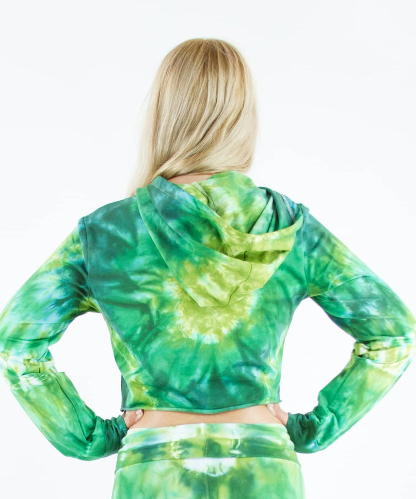 Load image into Gallery viewer, Woman wearing an Akasha Sun green tie dye crop top with a hood.