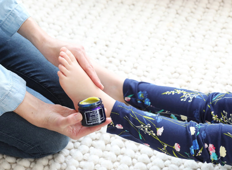 applying-avocado-peppermint-foot-balm-to-feet