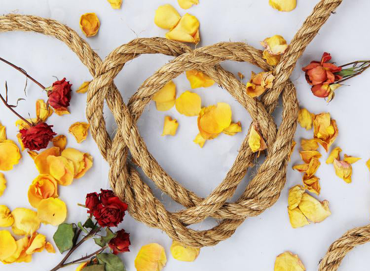 rope-in-the-shape-of-a-heart-surrounded-by-flowers