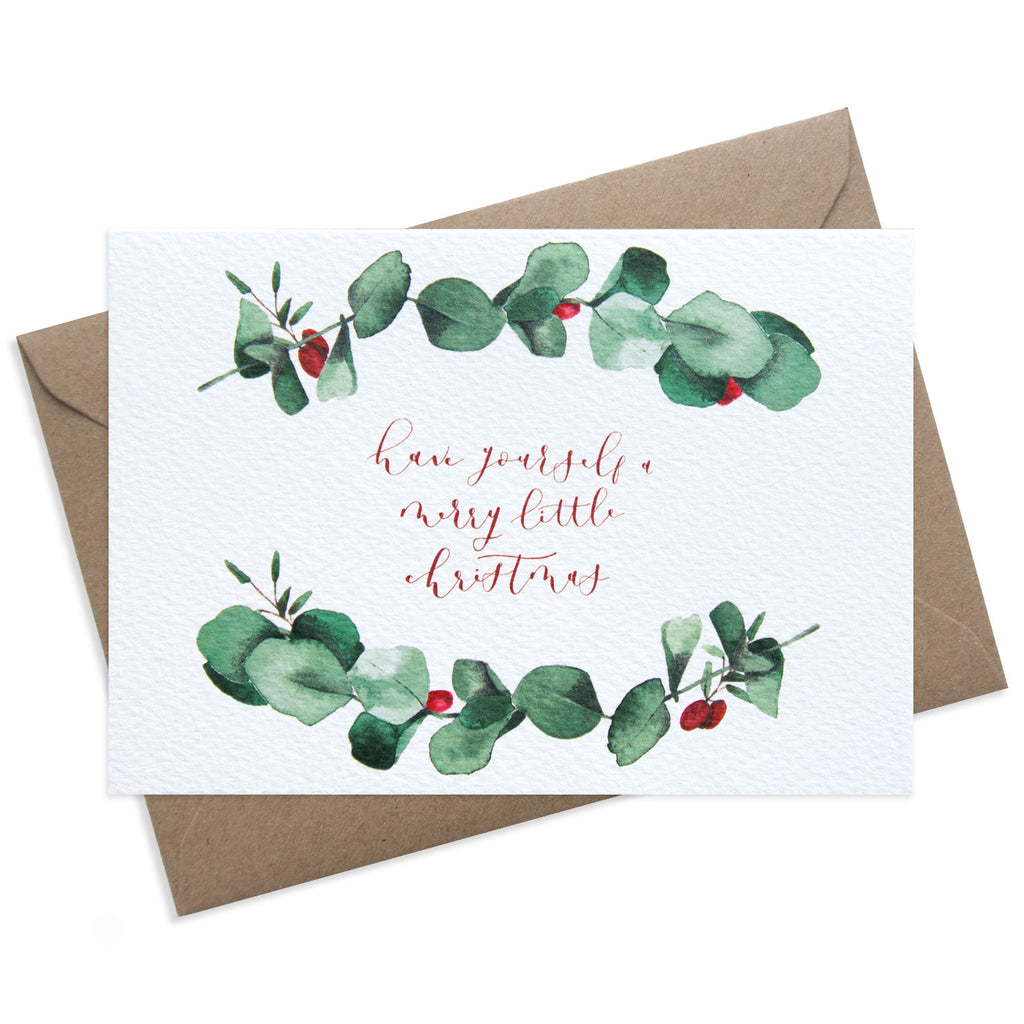 Paper Parade Stationers Christmas greeting card. With festive eucalyptus illustration. Front reads have yourself a Merry little Christmas and blank inside. A6 size with Kraft fleck envelope. Pack of 8 also available.