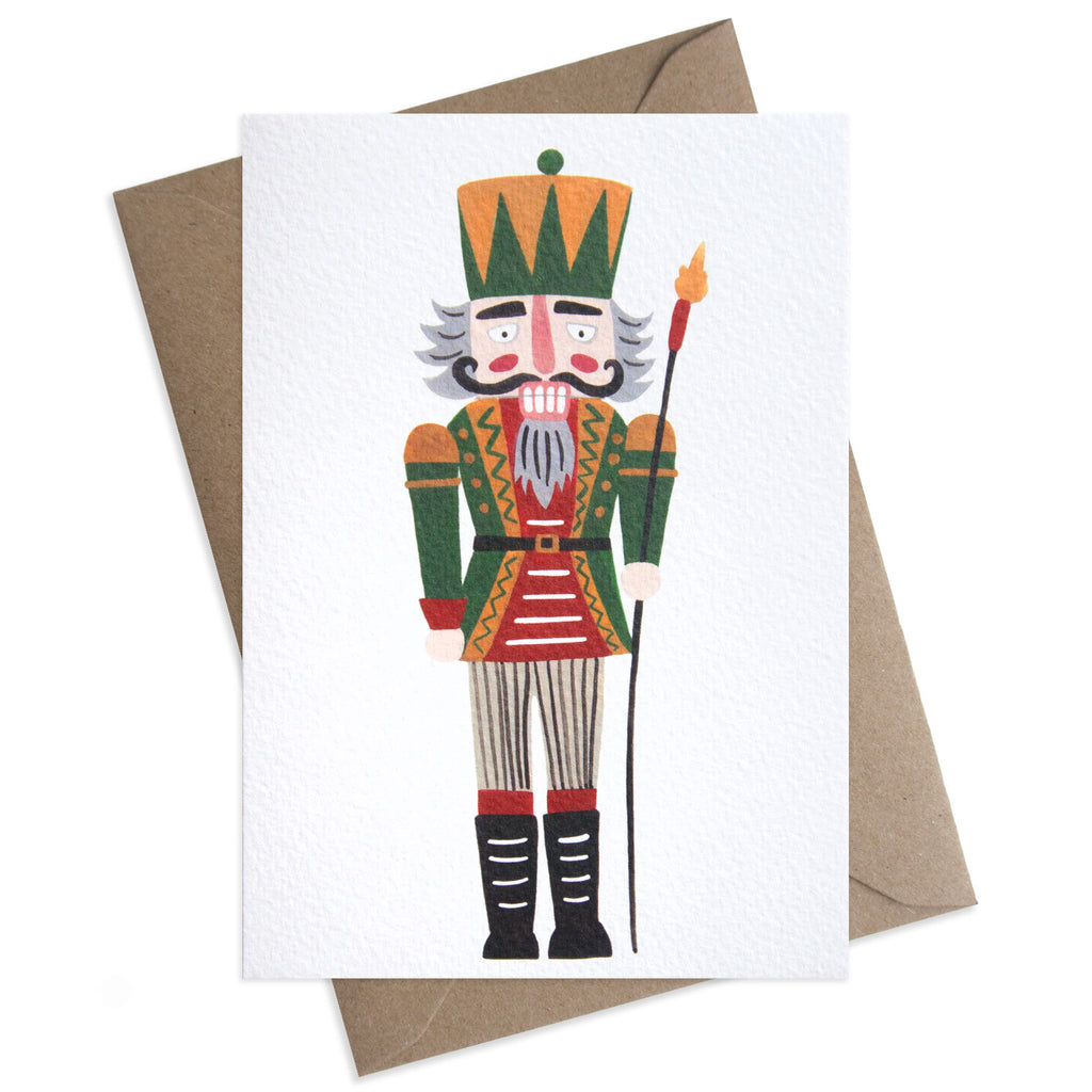 Paper Parade Stationers Christmas greeting card. With festive nutcracker toy illustration. Blank inside for your own message. A6 size with Kraft fleck envelope. Pack of 8 also available.