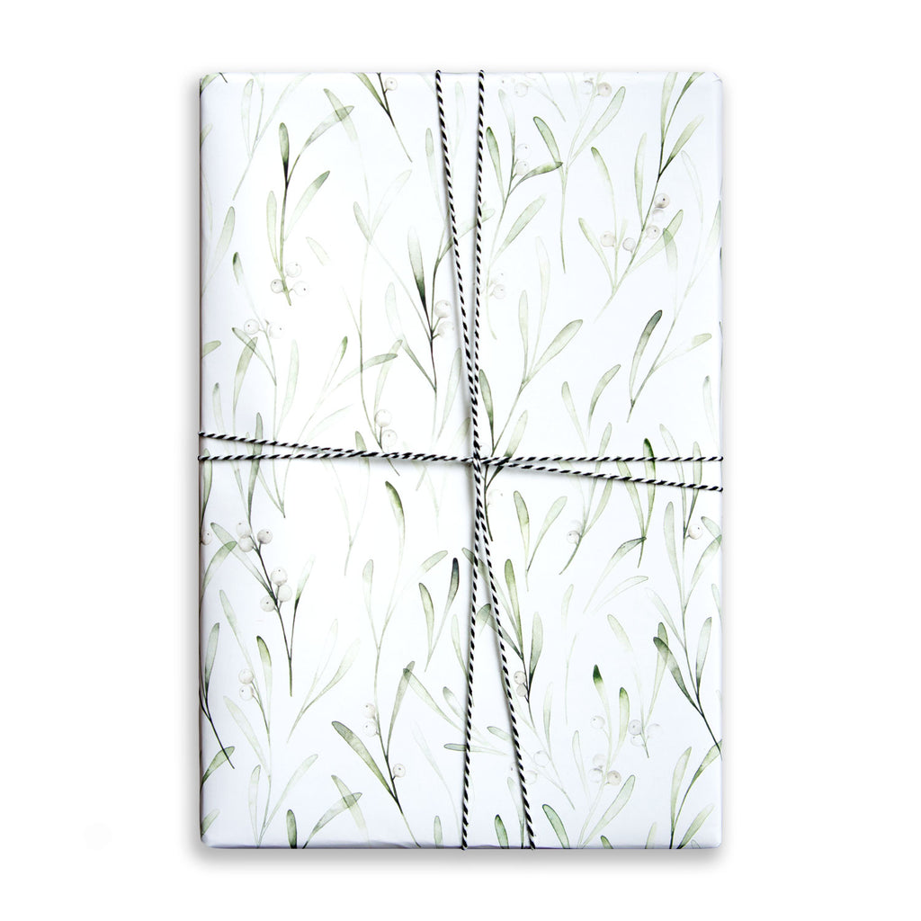 Paper Parade Stationers. Illustrated gift wrap sheet with watercolour mistletoe pattern. Matching gift tags available.