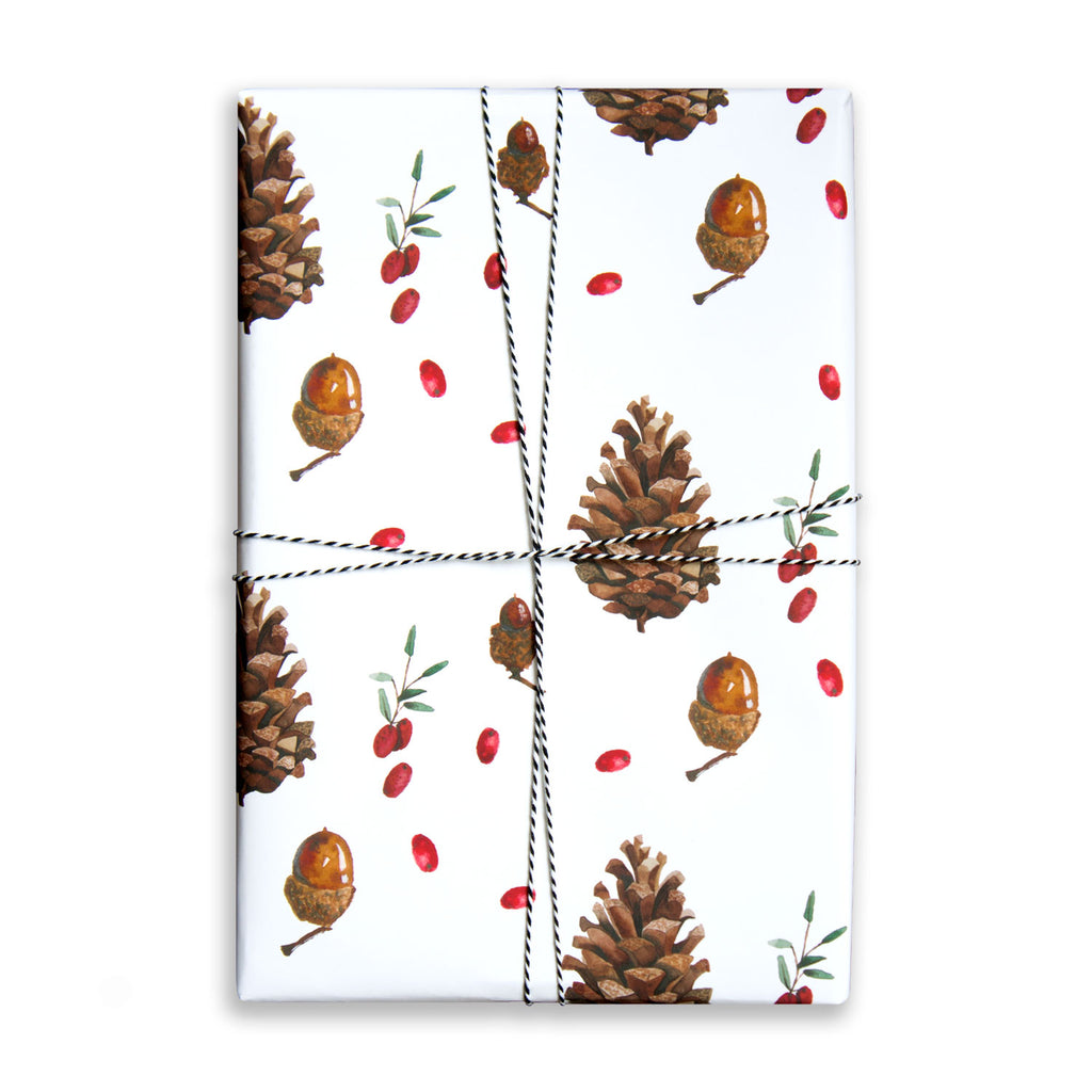 Paper Parade Stationers. Illustrated Christmas gift wrap sheet with watercolour pinecone and berries pattern. Matching gift tags available.