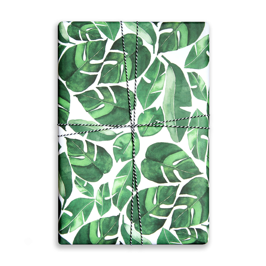 Single sheet of patterned gift wrap. Tropical monstera leaves foliage pattern, watercolour.