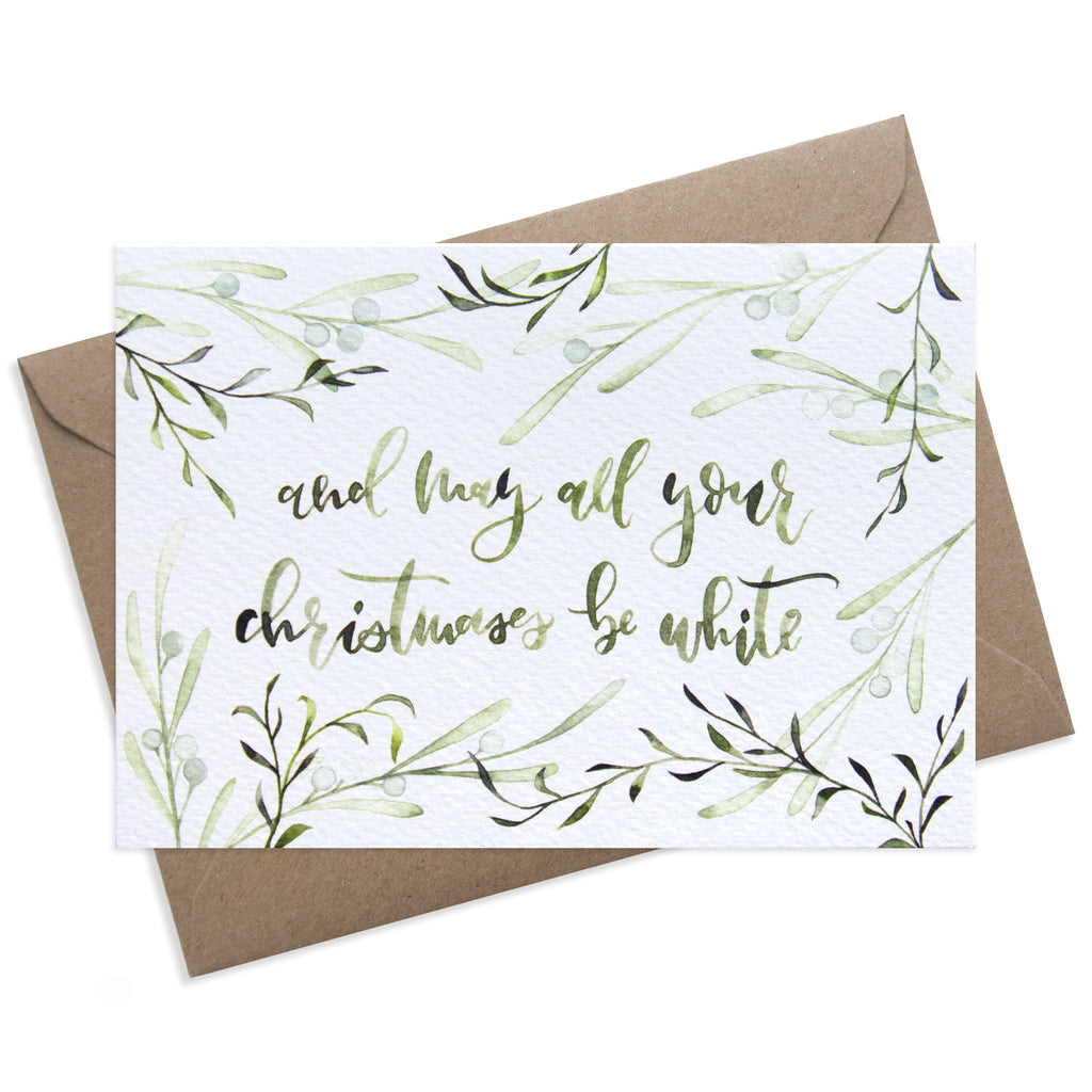 Paper Parade Stationers Christmas greeting card. With festive botanical foliage illustration. Front reads: And may all your Christmases be white. Blank inside for your own message. A6 size with Kraft fleck envelope. Pack of 8 also available.