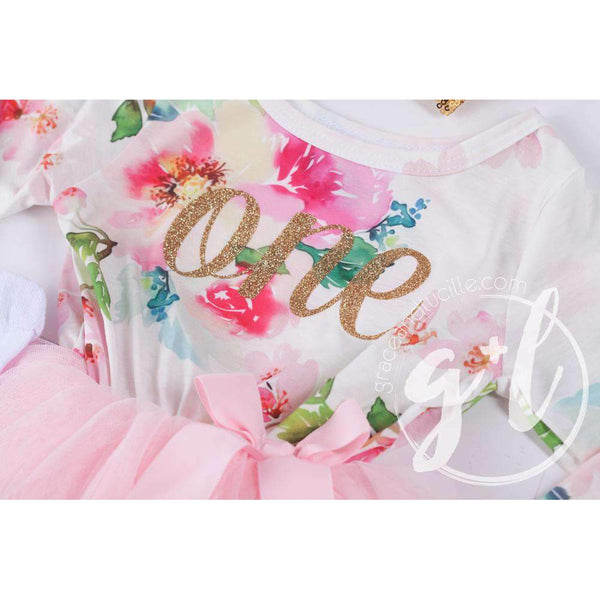 "1st Birthday Outfit Gold Script ""ONE"" Pink Floral Long Sleeve Dress, White Leg Warmers & Gold Bow Pink Headband - Grace and Lucille"