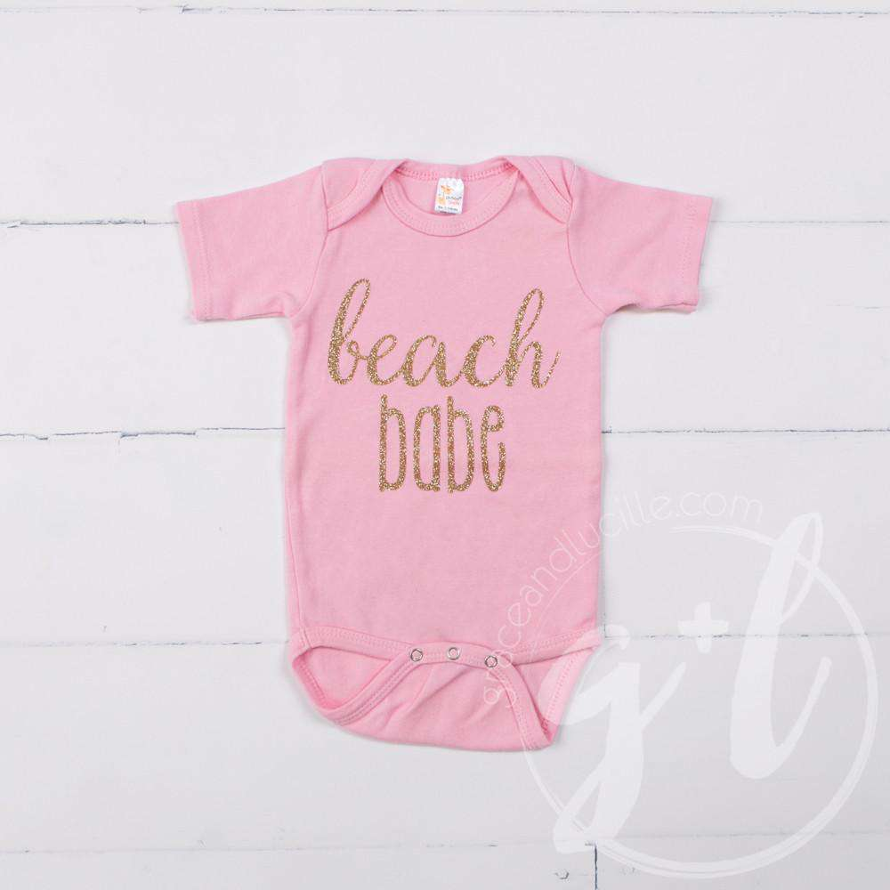 "Pink Onesie with ""BEACH BABE"" Gold Graphics - Grace and Lucille"