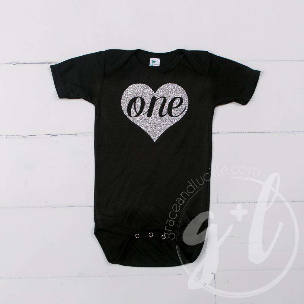 "Black Onesie with Silver Heart & ""ONE"" - Grace and Lucille"