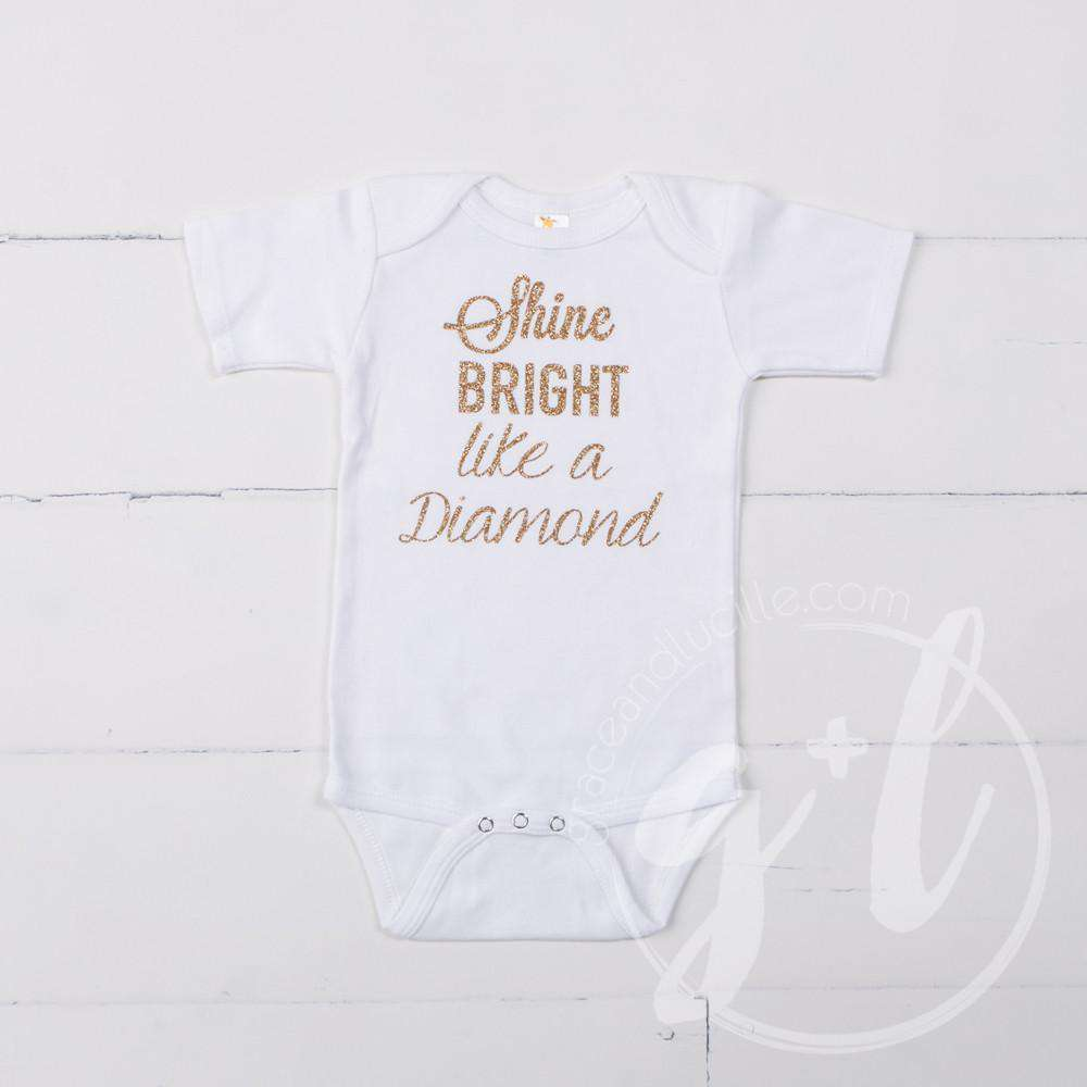 "White Onesie with""SHINE BRIGHT LIKE A DIAMOND"" Gold Graphics - Grace and Lucille"