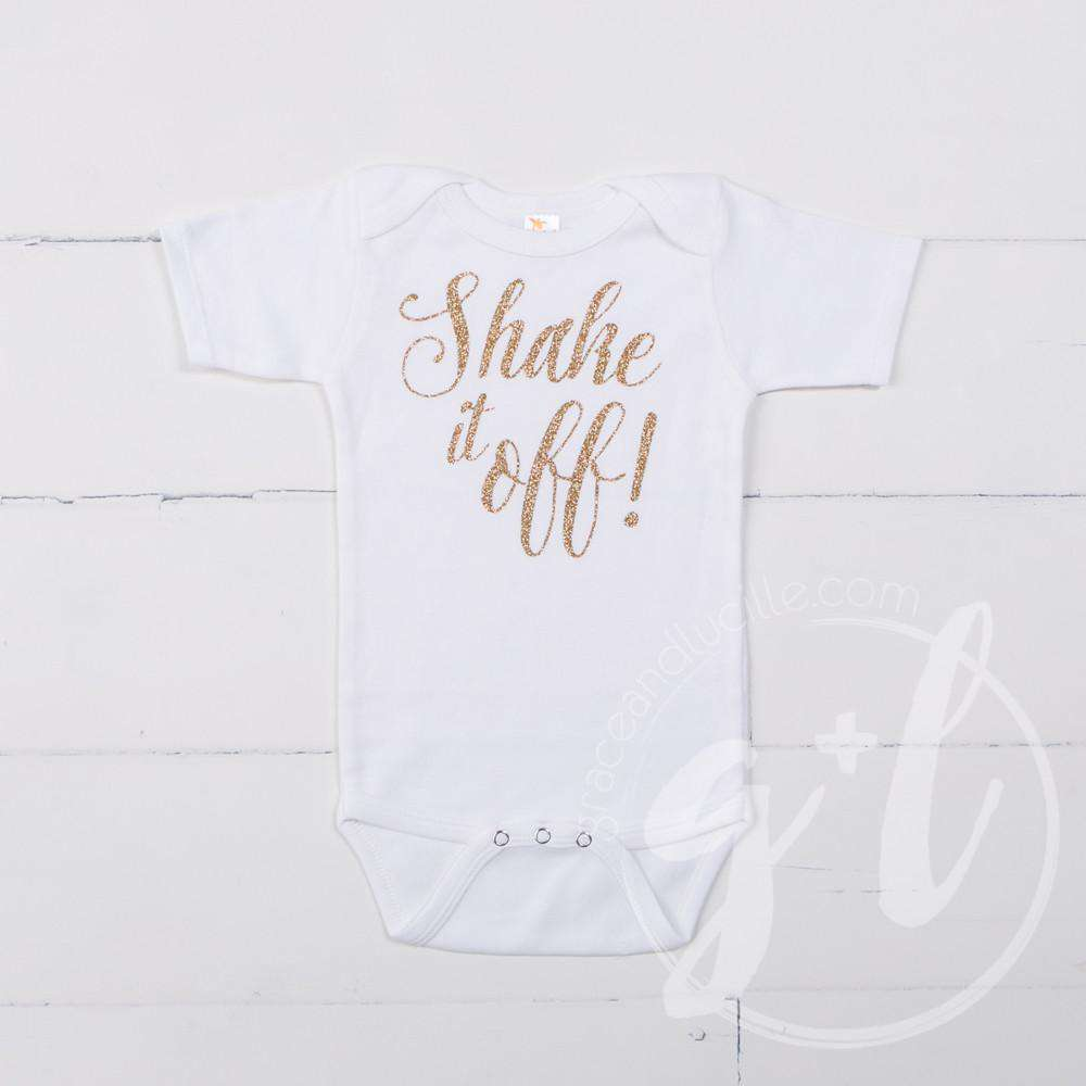 "White Onesie with ""SHAKE IT OFF!"" Gold Graphics - Grace and Lucille"