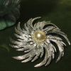 silver pinwheel brooch with pearl