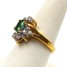 Gold Tone Ring Adorned with Center Green Stone and Rhinestones
