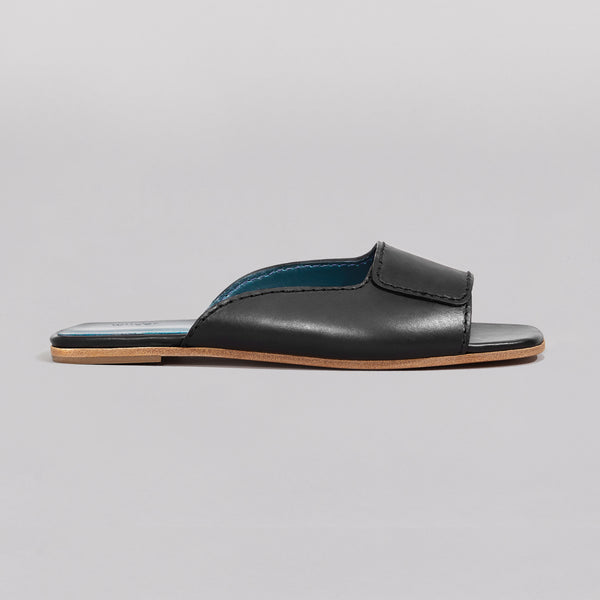 Wilder shoes - black women's flat slide sandal in black - maude - profile view