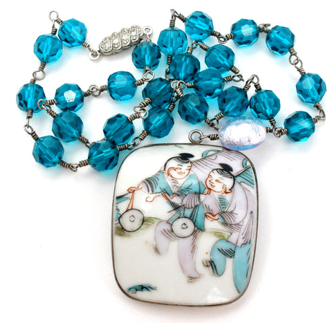 Blue Bead Necklace with Asian Pendant