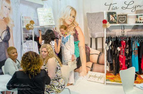 Tia Lyn presents her latest styles to buyers at the Javits Convention Center in NYC