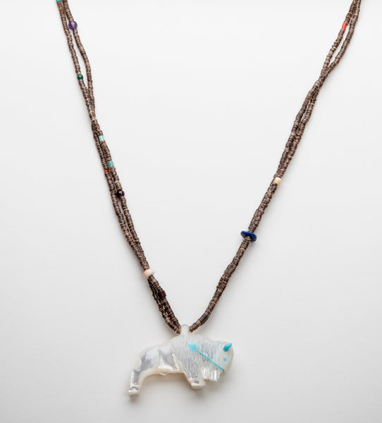 A Reversible Mother-Of-Pearl Bison Pendant Necklace