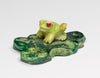 Tiny Frog On A Lily Raft