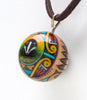 Reversible Hand-Painted Badger & Zuni Sunface Wooden Pendant