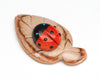 Apple Coral, Jet & Turquoise Ladybug On Dolomite Leaf