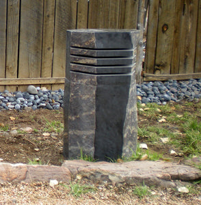 Stone lantern on the side of garden path