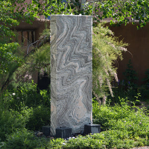 Outdoor fountain: solid marble ribbed waterwall fountain