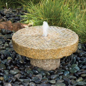Outdoor fountain: small antique millstone fountain
