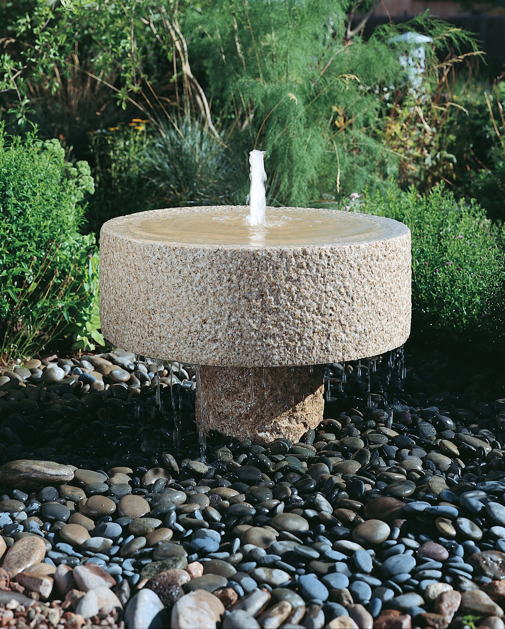 Rough Millstone Fountain with pedestal