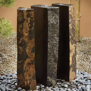 Triple basalt fountain in outdoor garden