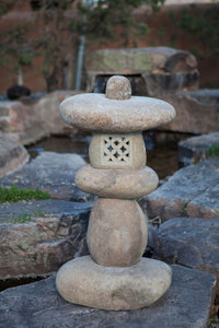 River stone lantern by water fall