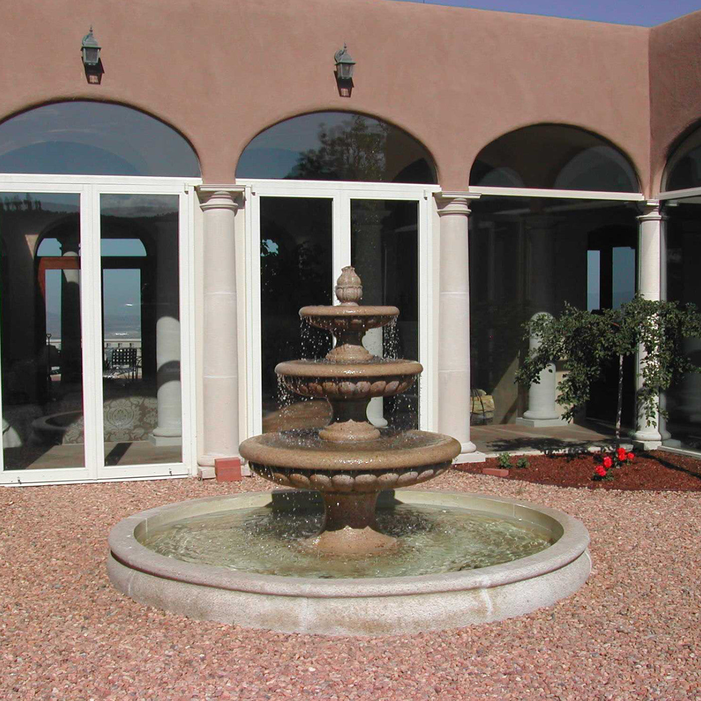 Three tier fountain in outdoor courtyard garden