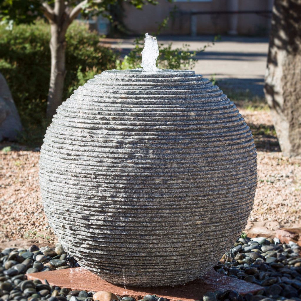 Ribbed sphere fountain is an outdoor fountain with unique water movement