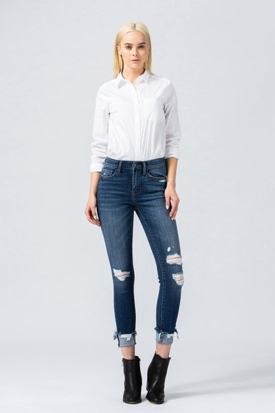 Denny Mid Rise Distressed Jeans With Slanted Cuff