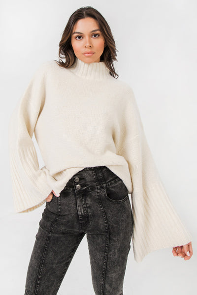 White Exaggerated Bell Sleeved Ribbed Turtleneck