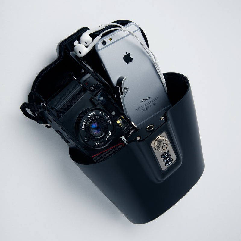 black portable safego for iphone and camera