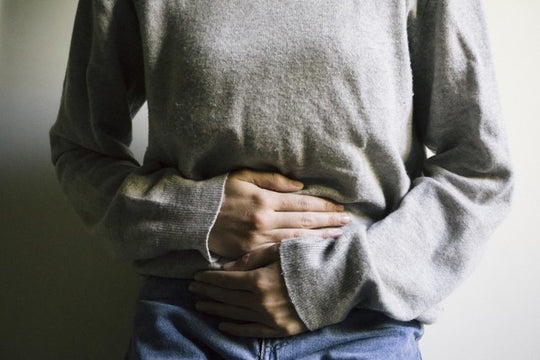 Woman holding stomach from cramping