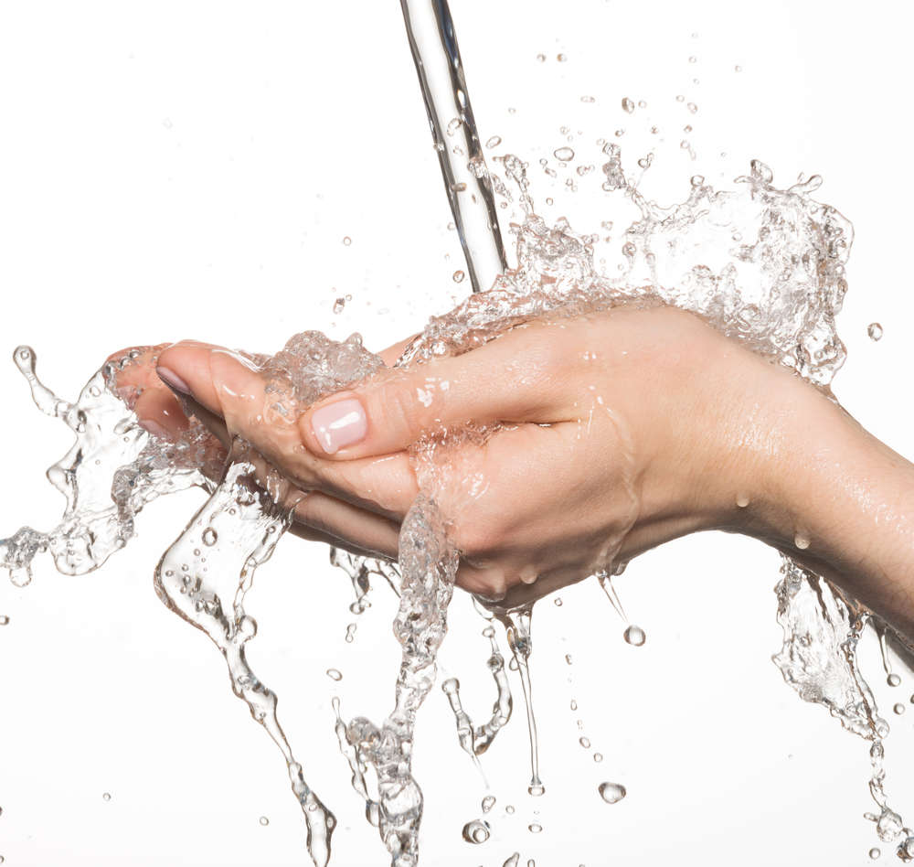 Water splashing over hands