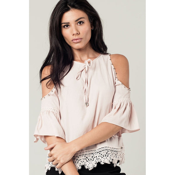 Cold shoulder top with studs and ruffled sleeves in pink