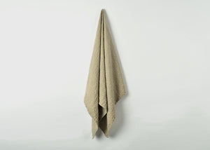 diamond weave bath towel draped over hook