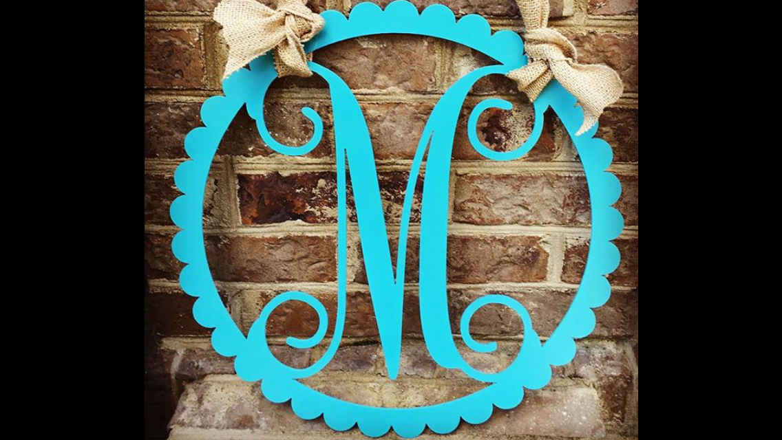 ''Monogram in scalloped circle frame