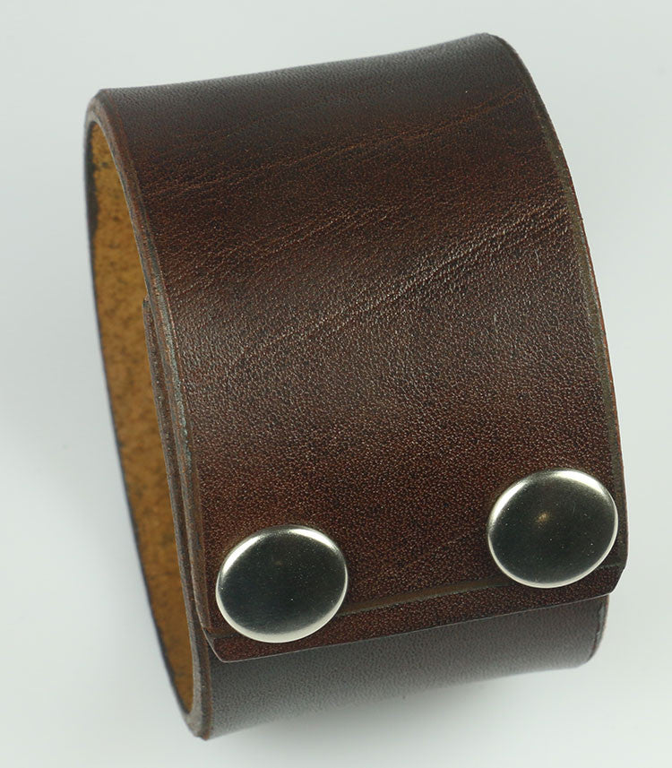 "plain brown wristband with snaps, 1 5/8"" wide"
