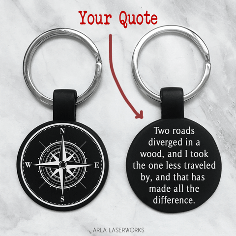 "custom engraved keychain. features a detailed compass on one side and a personalized quote or message on the back . permanent laser engraving by arla laserworks. 1"" round keychain"